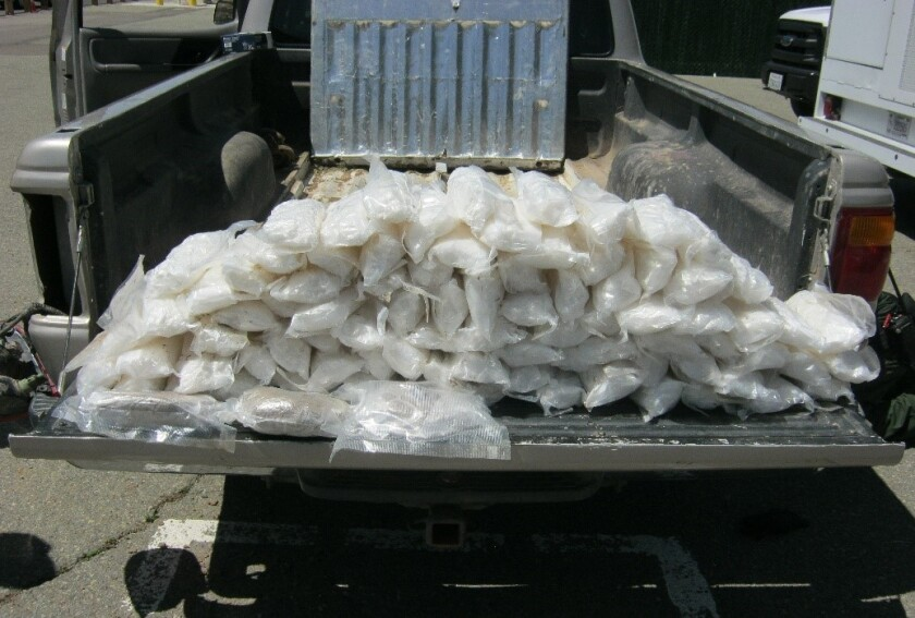 More than 80 bundles of methamphetamine and heroin was found in a pickup's hidden compartment when Border Patrol agents searched the vehicle.
