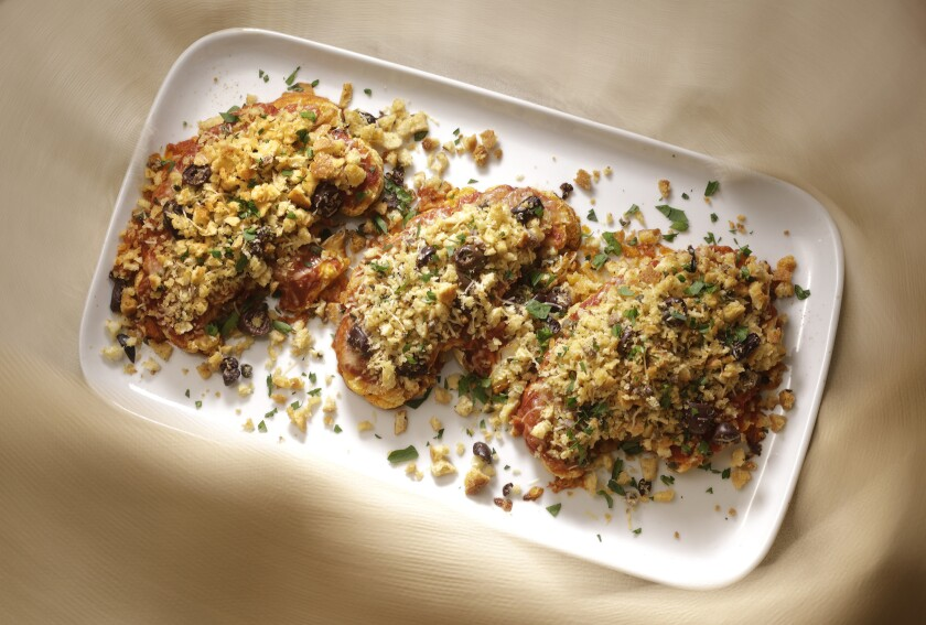 Cauliflower steaks with garlicky breadcrumbs.