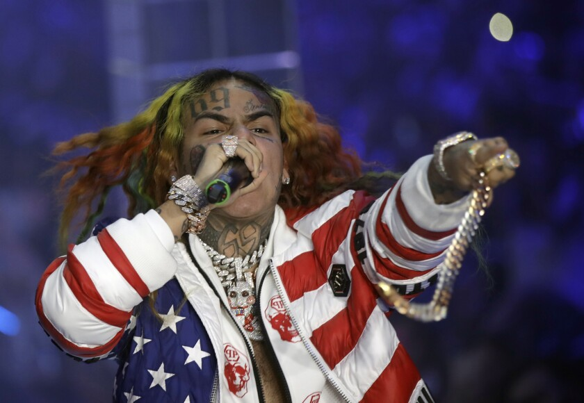 FILE- In this Sept. 21, 2018, file photo rapper Daniel Hernandez, known as Tekashi 6ix9ine, performs during the Philipp Plein women's 2019 Spring-Summer collection, Milan, Italy. A New York jury began deliberations on Wednesday, Oct. 2, 2019, the federal trial of two alleged members of the Nine Trey Gangsta Bloods, a gang that the up-and-coming rapper joined to give himself street credibility. (AP Photo/Luca Bruno, File)