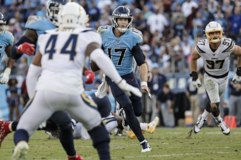 Titans quarterback Ryan Tannehill scrambles for yardage in the fourth quarter against the Chargers.