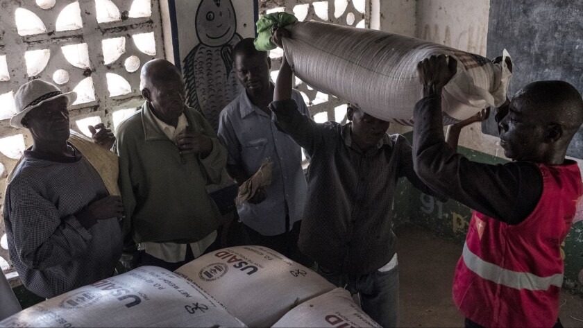 Bags of sorghum are distributed at a school in the village of Malikopo, which lies in Chikwawa -- one of the regions of Malawi most affected by drought.