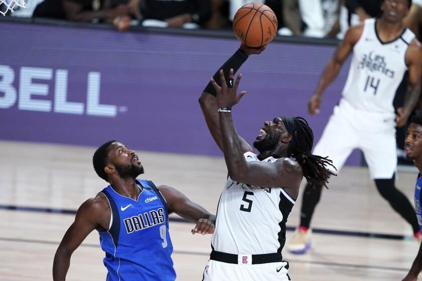 Clippers' Montrezl Harrell shoots over Dallas Mavericks' Michael Kidd-Gilchrist.