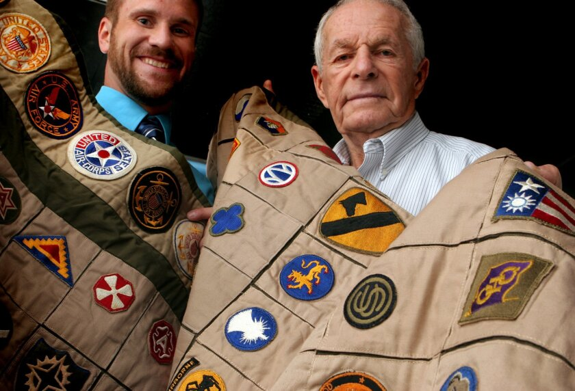 Steve Leader (left) and Harry Kaplan, a World War II vet, with Kaplan's patch from China, Burma and India on a quilt Leader made.