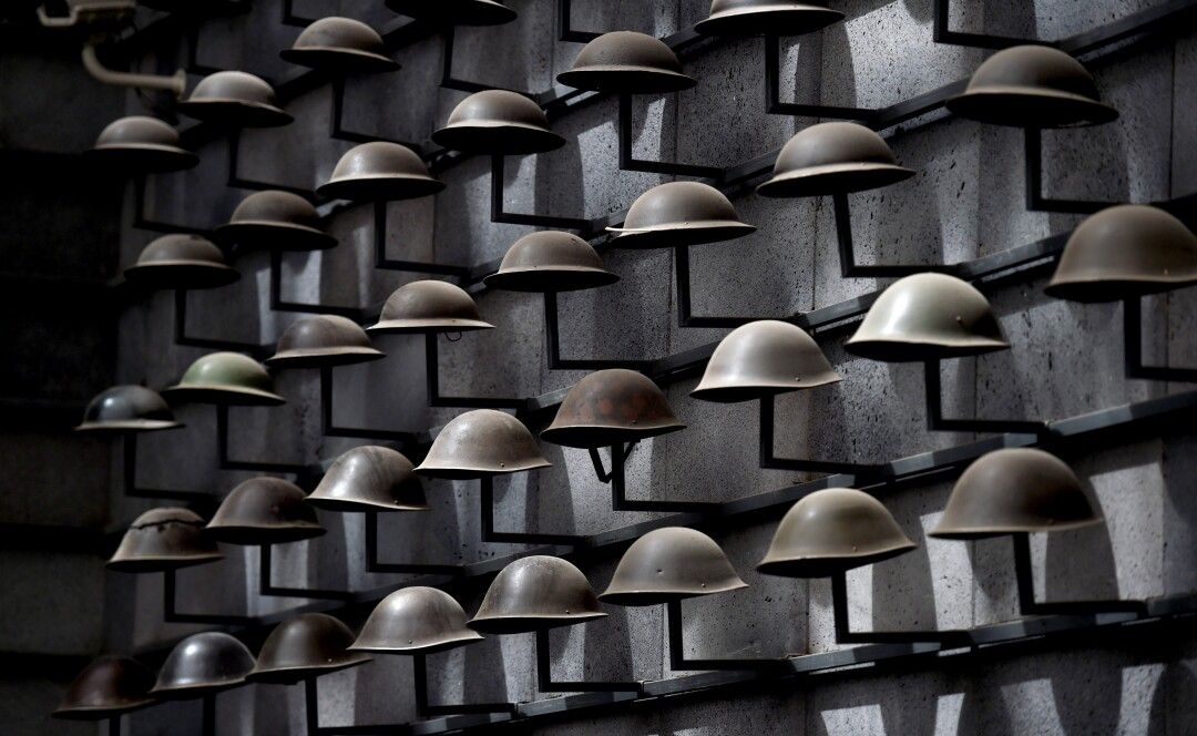 Military helmets on display at the martyrs cemetery museum in Tengchong, China.