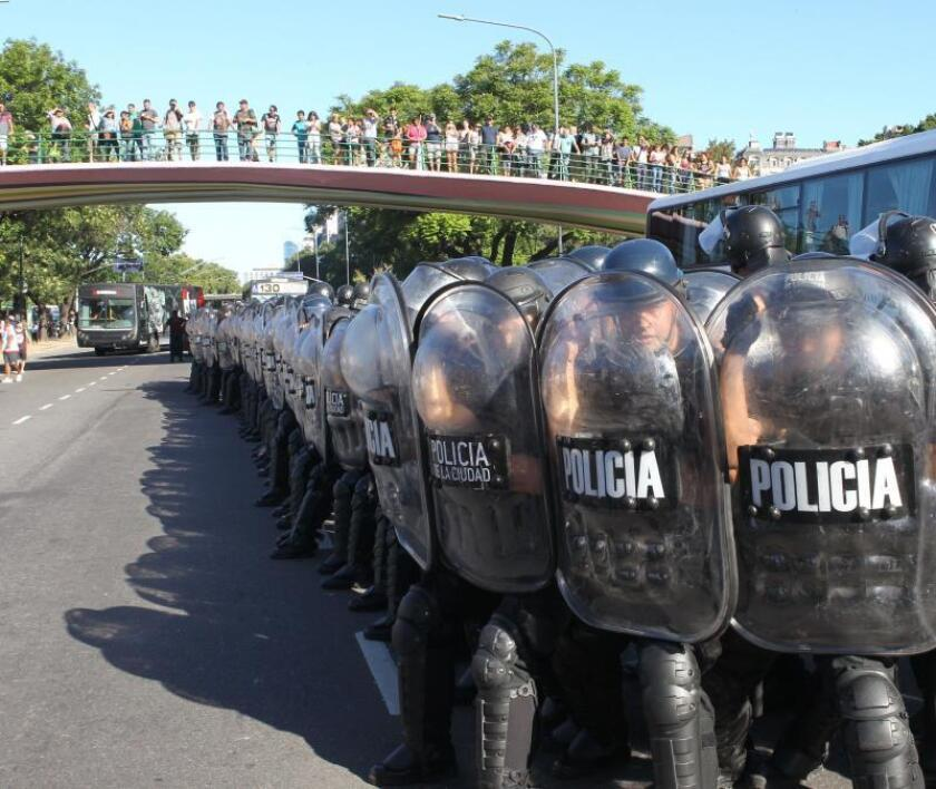 """Argentine police deploy along the route taken by social organizations, unions and leftist political groups, who marched on the US Embassy in Buenos Aires on Feb. 5, 2019, to protest Washington's """"interference"""" in Venezuela. EFE-EPA/ Marina Guillen"""