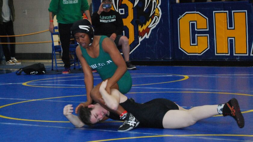Lincoln senior Phonisha Pruitt, a San Diego Section champion in her weight class, is the Union-Tribune All-Academic Team Captain for girls wrestling.