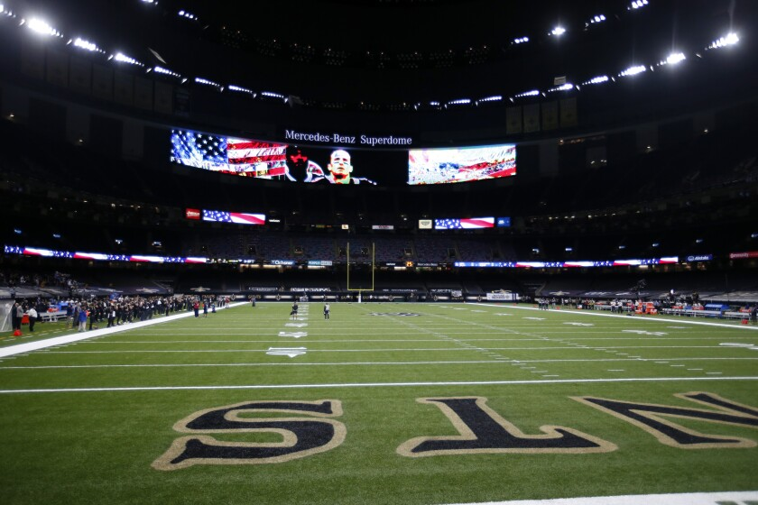 The New Orleans Saints stand for the National Anthem while the Green Bay Packers did not take to the field until after the Anthem, before an NFL football game in New Orleans, Sunday, Sept. 27, 2020. (AP Photo/Butch Dill)