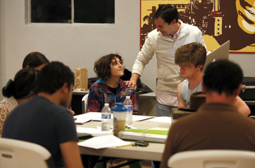Director George Yé shares a light moment with playwright Kirra McColl during a Playwrights Project rehearsal.