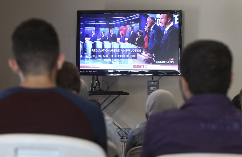 A group of young adults watch the Democratic presidential debate during a watch party, put on by Youth Will, at the Jacobs Center For Neighborhood Innovation on Wednesday, June 26, 2019 in San Diego, California.