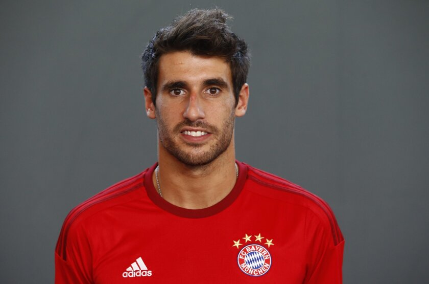 In this July 16, 2015 picture Bayern's Javi Martinez from Spain poses during a photo shooting for the upcoming German first division  soccer season in Munich, Germany. Pep Guardiola's dream of leading Bayern Munich to the treble in his last season in charge for a perfect farewell is in jeopardy due