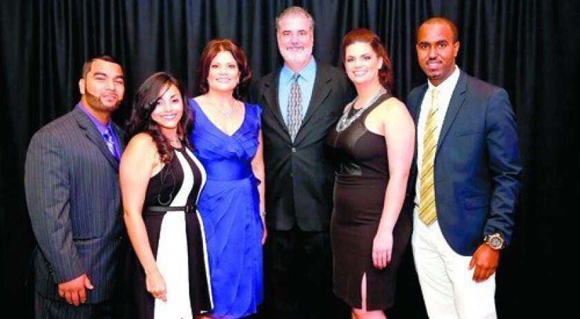 Andres Limon; Melissa Villa Gomez; Lynne Doyle; her husband, Steve Doyle, honoree; daughter Alyssa Doyle; and Abdi Yusuf