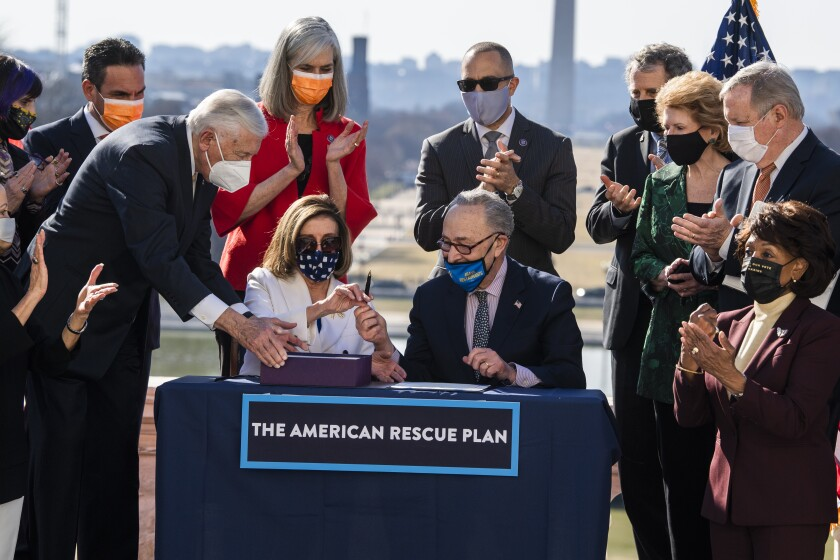 Democrats sign the American Rescue Plan Act at a bill enrollment ceremony.