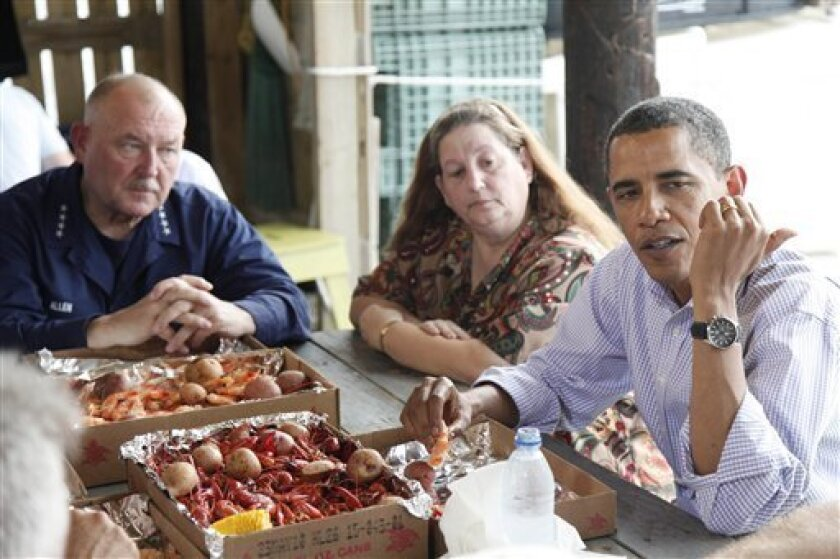 President Barack Obama is seated before boiled shrimp at a table with National Incident Commander Adm. Thad Allen, left, and convenience store owner Patti Rigaud at Camardelle's, a live bait and boiled seafood restaurant shop, to meet with residents regarding the BP Gulf Coast oil spill in Grand Isle, Louisiana, Friday, June 4, 2010. (AP Photo/Charles Dharapak)