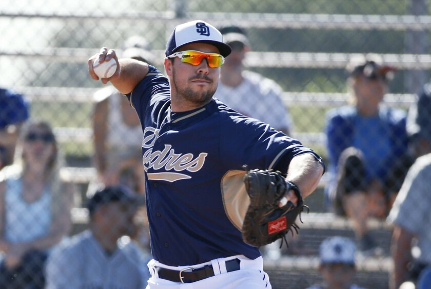 Padres catcher Austin Hedges steps into a throw to second during drills prior to a spring training baseball game against the San Francisco Giants Tuesday, March 10, 2015, in Peoria, Ariz.