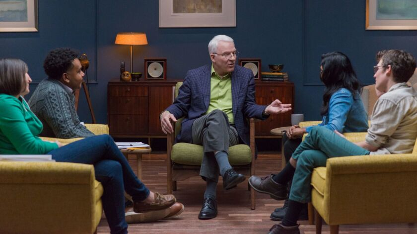 Steve Martin speaks with a group of aspiring comedians during his course.