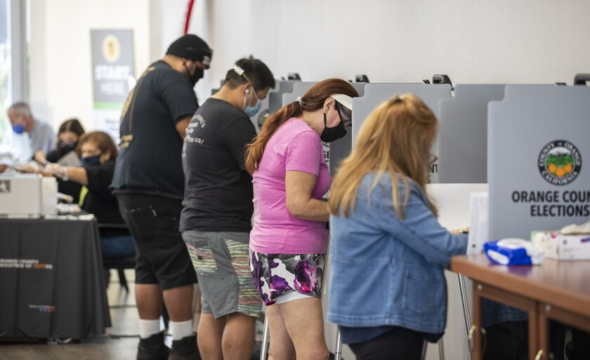 Voters cast their ballots Tuesday at the Costa Mesa City Hall voting center.