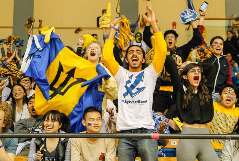 Fans cheer the UCSD women's basketball team during the Tritons' game against Cal Poly in February 2019.