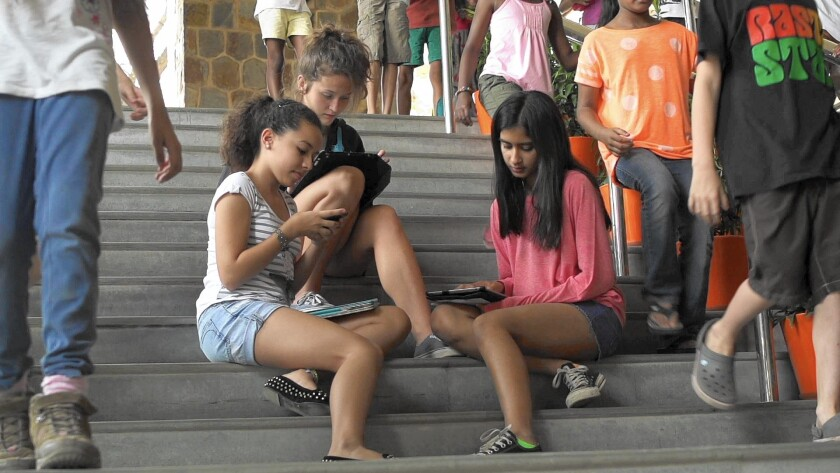 "Youths spend 6.5 hours a day perusing screens, according to the documentary ""Screenagers."""