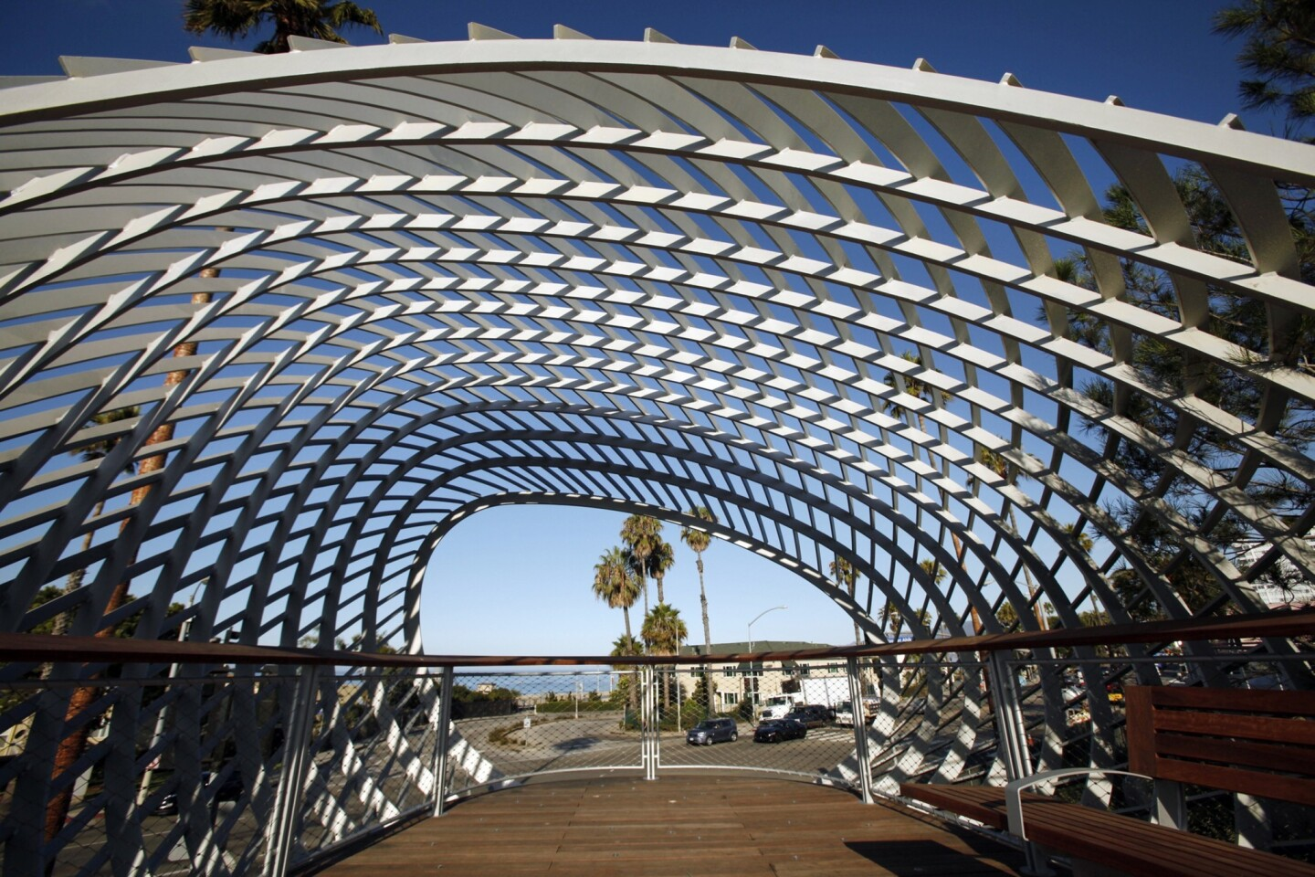 A sculptural form, resembling both curling wave and woven basket, envelops a viewing platform in Santa Monica's new Tongva Park, across Main Street from City Hall and near the coming terminus of the Expo Line.