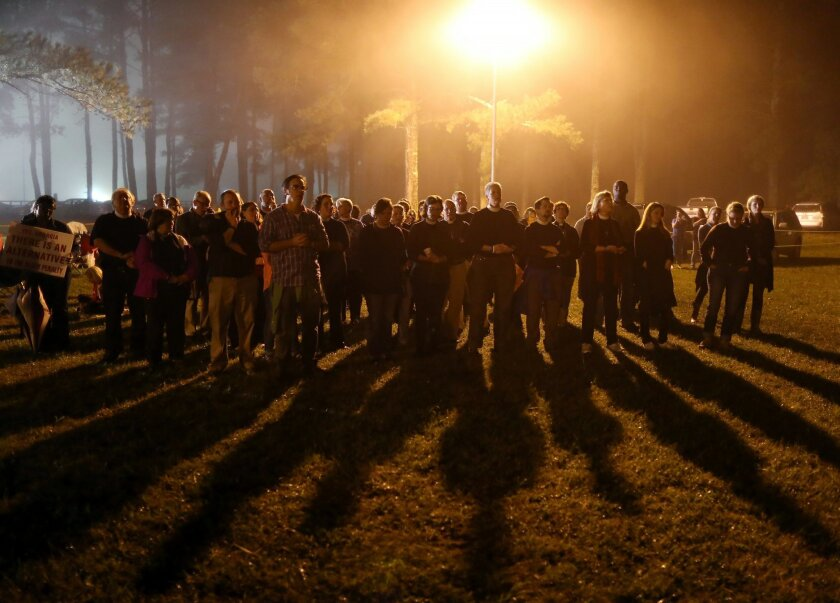 Protesters sing outside of Georgia Diagnostic Prison in Jackson, Ga., Tuesday, Sept. 29, 2015, before the scheduled execution of Kelly Renee Gissendaner. Gissendaner, who was scheduled to die by lethal injection Tuesday, was convicted of murder in the February 1997 slaying of her husband. (Ben Gray/Atlanta Journal-Constitution via AP) MARIETTA DAILY OUT; GWINNETT DAILY POST OUT; LOCAL TELEVISION OUT; WXIA-TV OUT; WGCL-TV OUT; MANDATORY CREDIT