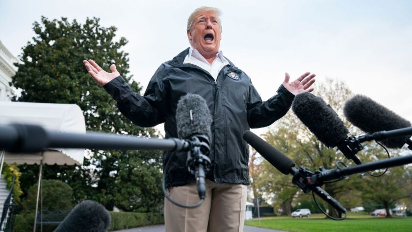 As he leaves the White House for California on Nov. 17, President Trump speaks to reporters about the investigation into Jamal Khashoggi's death.