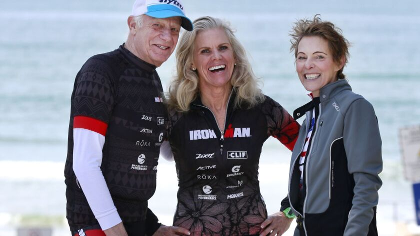 "Ironman legend Kathleen McCartney, center, organized the ""Ironman in Minutes"" event, where participants re-create a mini Ironman for pancreatic cancer awareness. The first honoree was Mike Levine, left, and this year's is Katie Gutzwiller, right, at the annual event Sunday."