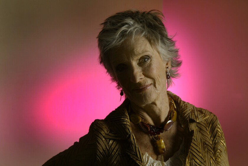 Cloris Leachman photographed in front of a pink background in 2004.