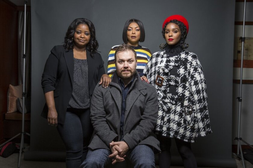 """""""Hidden Figures"""" director Theodore Melfi, was joined by the women of the cast -- Octavia Spencer, left, Taraji P. Henson and Janelle Monáe -- to talk about the film's effect."""