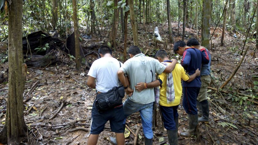 Friends of neighbors of the 7 killed and 21 wounded in the Oct. 5 shooting of coca farmers by Colomb