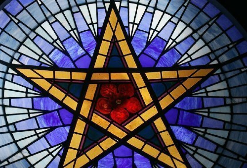 """A stained-glass star with a rose center sits atop """"The Ecclesia,"""" the Rosicrucian Fellowship's healing temple. The centennial milestone has re-energized the fellowship."""