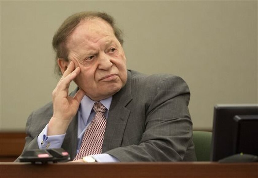 Las Vegas Sands Corp. CEO Sheldon Adelson testifies for a second day in Clark County district court, Friday, April 5, 2013, in Las Vegas. Attorneys for Hong Kong businessman Richard Suen say Sands owes him $328 million because he worked behind the scenes to help the company win a gambling license in the Chinese enclave of Macau. (AP Photo/Julie Jacobson)