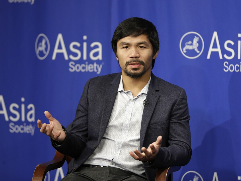 Manny Pacquiao takes questions at the Asia Society in New York on Oct. 12.