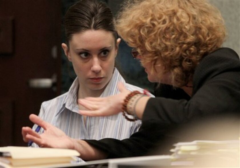 Casey Anthony listens to her attorney Dorothy Clay Sims during her trial at the Orange County Courthouse on Saturday, June 4, 2011 in Orlando, Fla. Anthony, 25, is charged with murder in the 2008 death of her daughter Caylee. If convicted, she could be sentenced to death. (AP Photo/Red Huber, Pool)