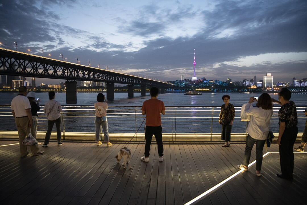 The Yangtze River at dusk next to Wuhan Yangtze River Bridge in Wuhan, China.