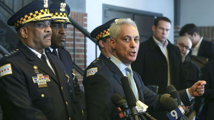Chicago Mayor Rahm Emanuel, right, and Chicago Police Supt. Eddie T. Johnson, far left, appear at a news conference in Chicago on Tuesday.