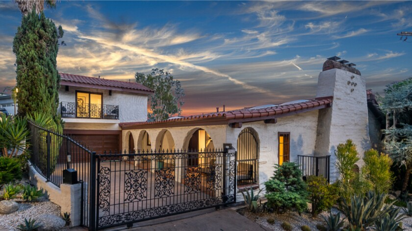 The Spanish-style home takes in sweeping city views from decks on both levels.