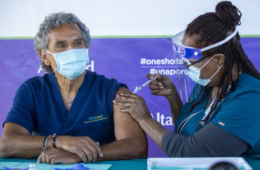 Former Los Angeles Mayor Antonio Villaraigosa receiving the COVID-19 vaccine.