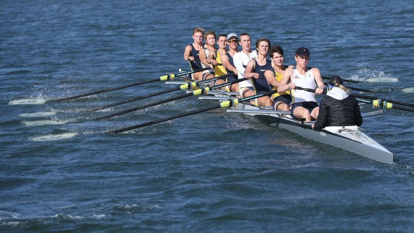 The Newport Aquatic Center boys' varsity 8 boat pulls through the Back Bay during a practice in 2018. The Newport Aquatic Center facility has been closed since March 21 due to the coronavirus pandemic.