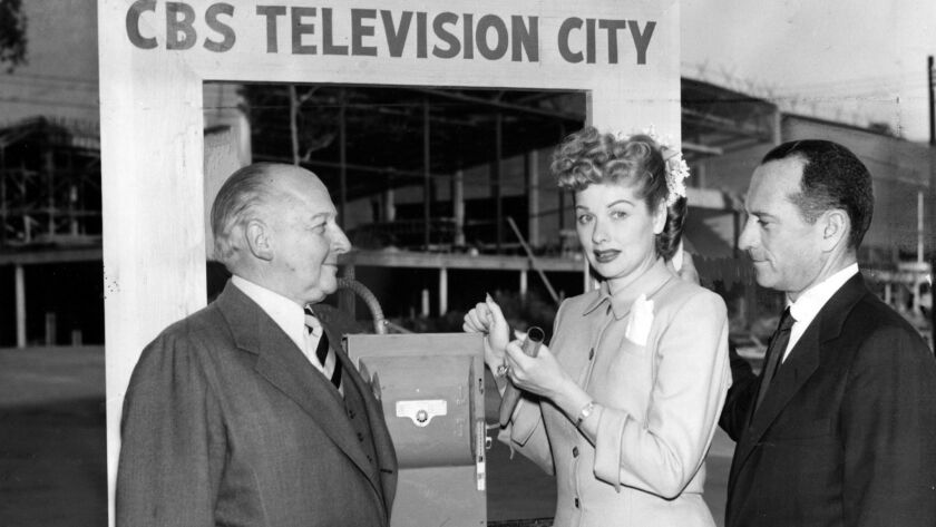 Actress Lucille Ball, center, turns on floodlights during a 1952 promotional event at the site of CBS Television City studios, which was still under construction.