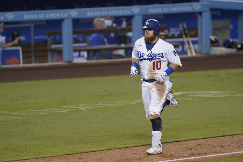 The Dodgers' Justin Turner rounds the bases after homering during the third inning Friday.