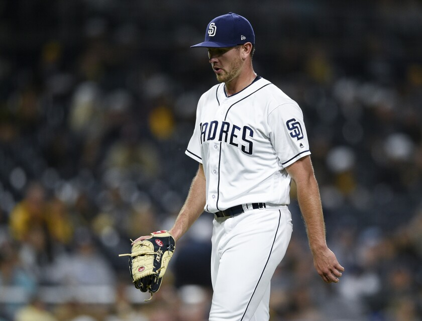 Padres starting pitcher Nick Margevicius walks off the field after being taken out of Saturday's game against the Miami Marlins during the fourth inning.