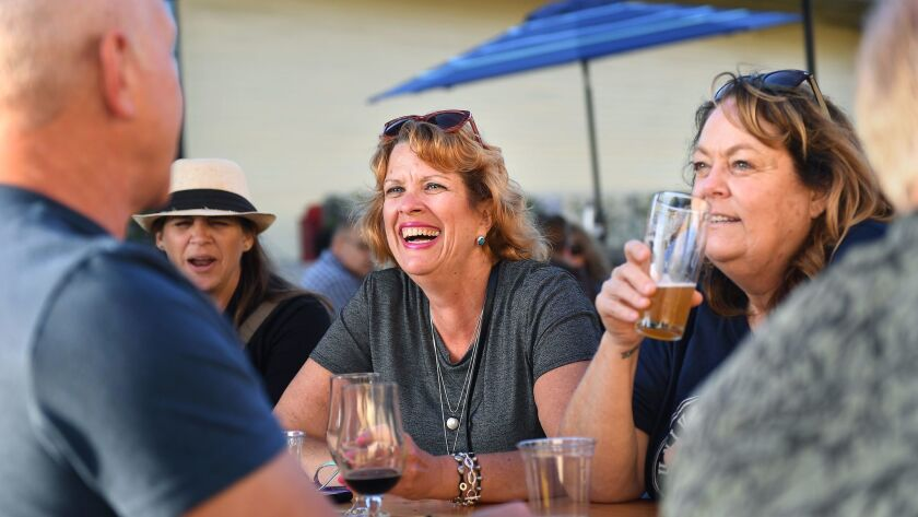 Customers sit outside the Brouwerij West in San Pedro on a Friday afternoon.