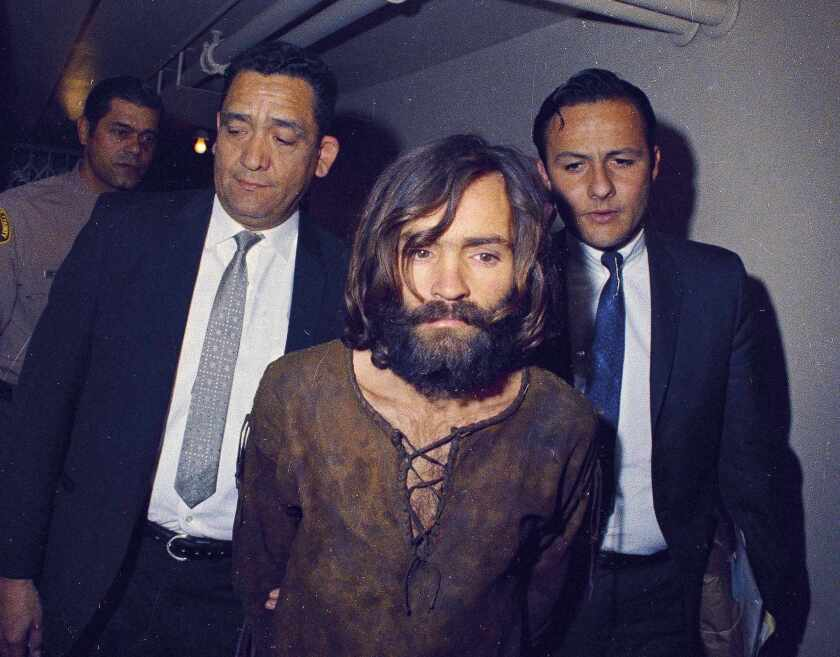 Charles Manson is escorted into court in 1969.
