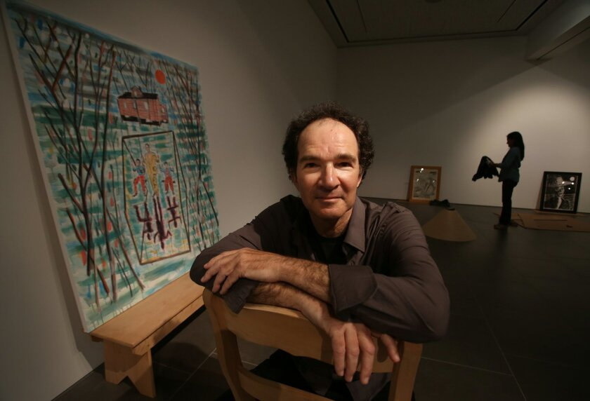 Artist Ernest Silva with his work at the Oceanside Museum of Art.