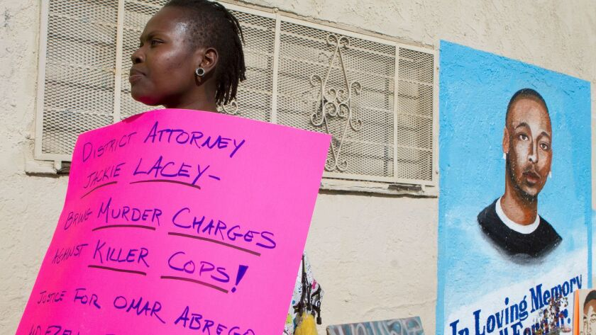 LOS ANGELES CA January 3, 2015 -- Lawrencia Colding, center and other supporters gathered on 65th S