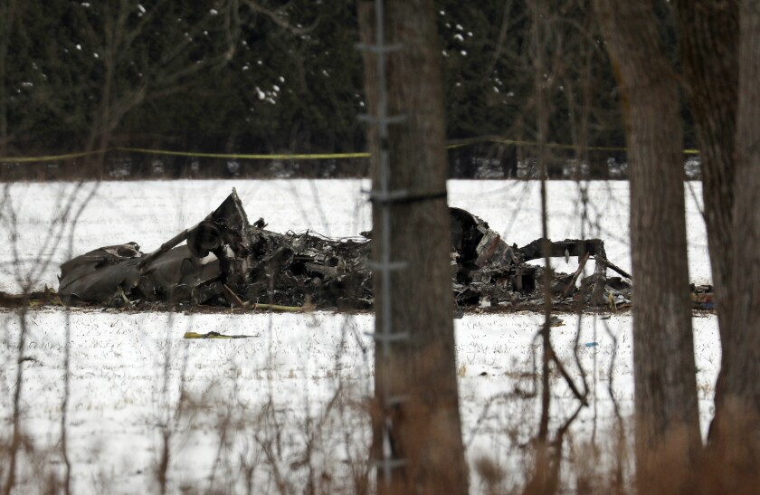 The wreckage of a UH-60 Black Hawk medical evacuation helicopter sits in a field in Mendon, NY., Thursday, Jan. 21, 2021. Three National Guard members were killed in the crash on Jan. 20. Officials say human error caused the crash of the Army National Guard helicopter during a January training exercise in upstate New York. (Tina MacIntyre-Yee/Democrat & Chronicle via AP)