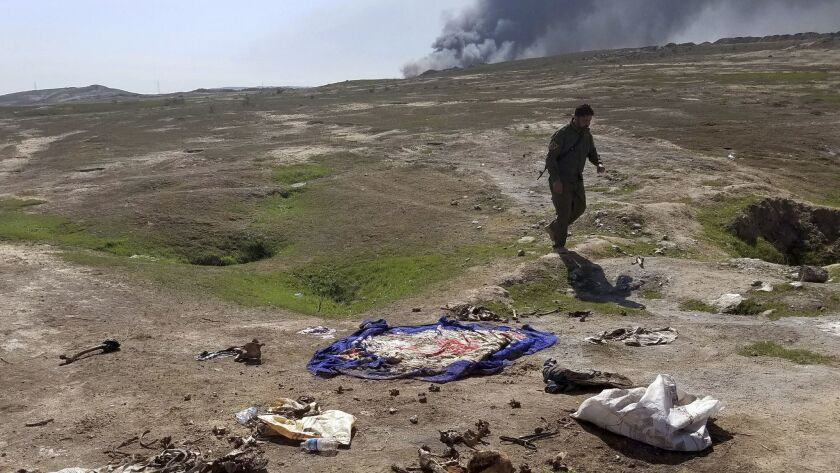 Sunni militia member Sgt. Major Yasser Ahmed, who has been digging at the mass grave to help identify those killed by Islamic State, said locals have grown frustrated with the central government for not sending experts to handle the exhumations.