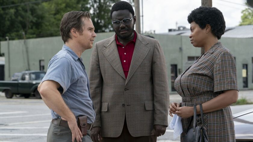 This image released by STXfilms shows, from left, Sam Rockwell, Babou Ceesay and Taraji P. Henson i