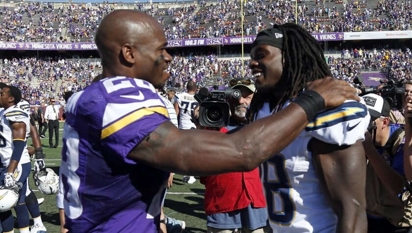 Vikings running back Adrian Peterson (left) speaks with Chargers rookie running back Melvin Gordon following a 31-14 Vikings win on Sept. 27, 2015.