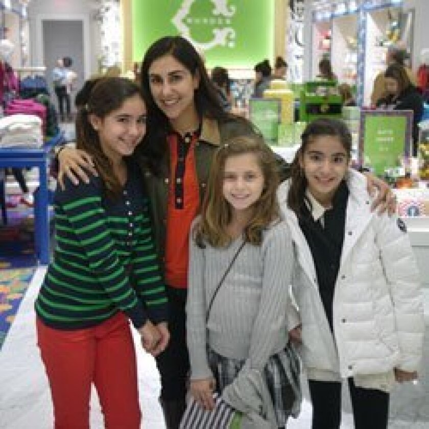 Helping to raise funds at the December SHaRE benefit held at C. Wonder in Fashion Valley were:  Sophie and Shirin Raiszadeh, Sophie Howard and Ariana Chadha.  Courtesy photos.
